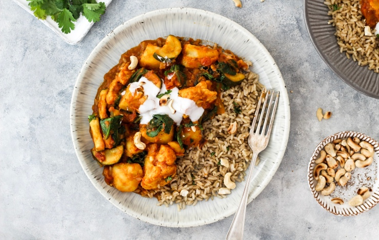 Vegan Vegetable Curry with coconut yoghurt, brown rice, roasted cashew nuts and coriander